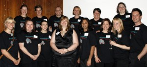 The AccessibilityOz team: Gian Wild with thirteen staff, wearing black AccessibilityOz tshirts